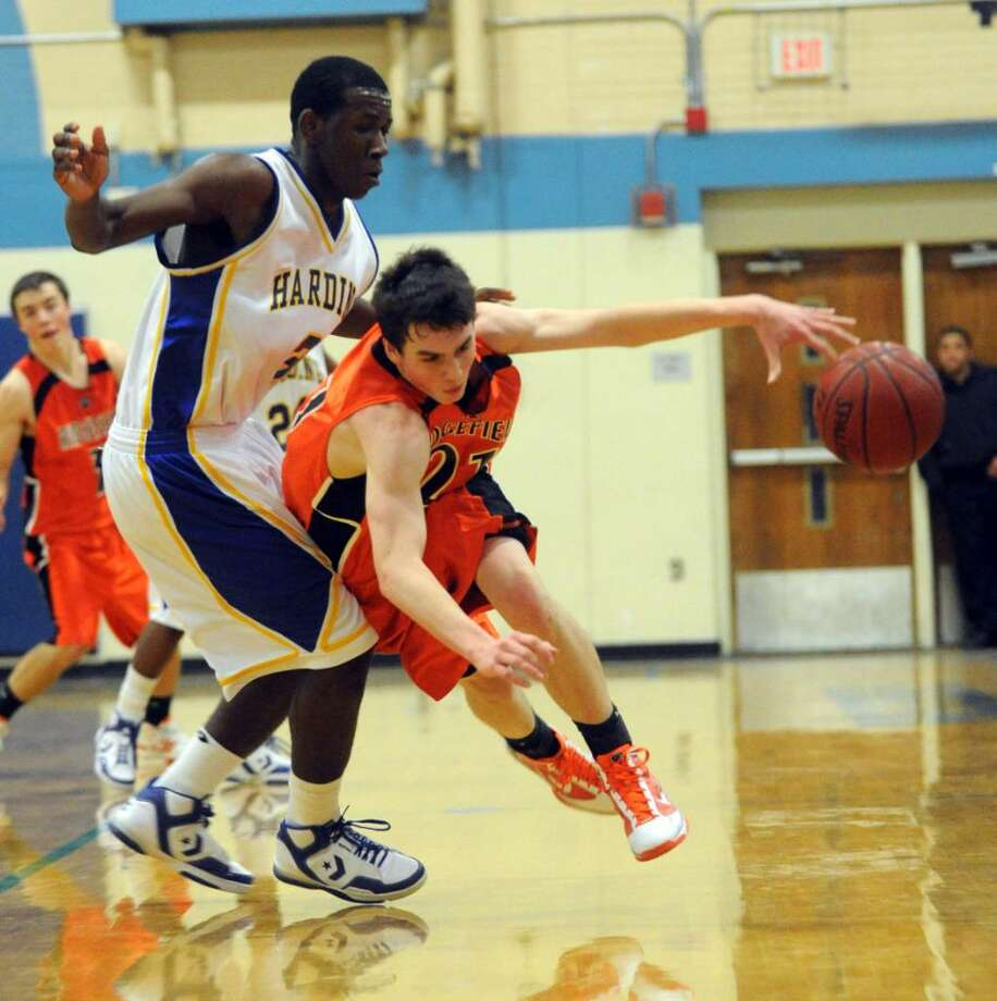 Harding hosts Ridgefield in basketball action in Bridgeport on Tuesday Feb. 02, 2010. Here, Ridgefield's Seth VonKuhn looses control of the ball as he moves it. Photo: Christian Abraham / Connecticut Post