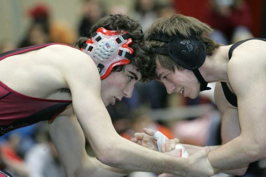 Greenwich High Schools Victor Cerio and Stamford's Dan Kowaleski go head to head during Tuesday evenings meet in Greenwich.