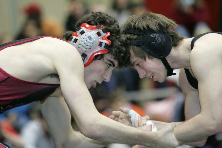 Greenwich High Schools Victor Cerio and Stamford's Dan Kowaleski go head to head during Tuesday evenings meet in Greenwich. Photo: David Ames, David Ames/For Greenwich Time / Greenwich Time