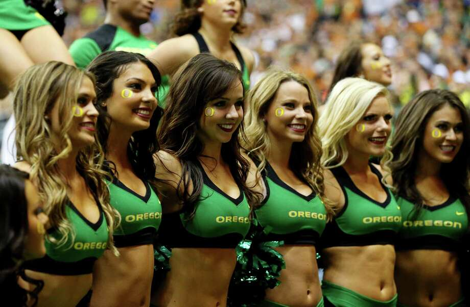 Oregon Ducks cheerleaders perform during the Valero Alamo Bowl against the Texas Longhorns at the Alamodome on December 30, 2013 in San Antonio, Texas. Photo: Ronald Martinez, Getty Images / 2013 Getty Images
