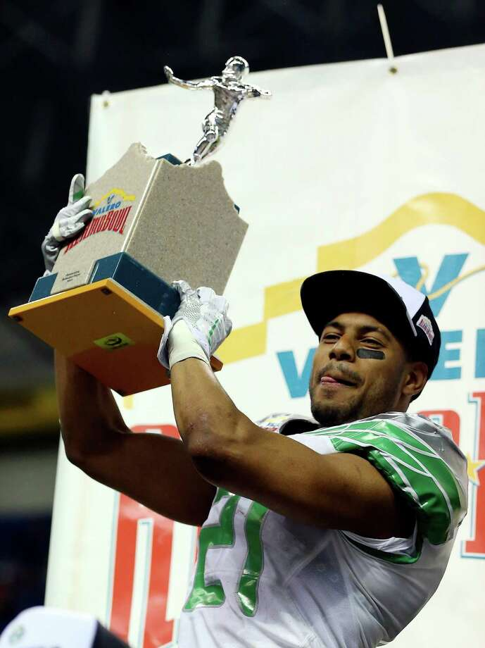 Cornerback Avery Patterson #21 of the Oregon Ducks celebrates on stage after defeating the Texas Longhorns 30-7 in the Valero Alamo Bowl at the Alamodome on December 30, 2013 in San Antonio, Texas. Photo: Ronald Martinez, Getty Images / 2013 Getty Images