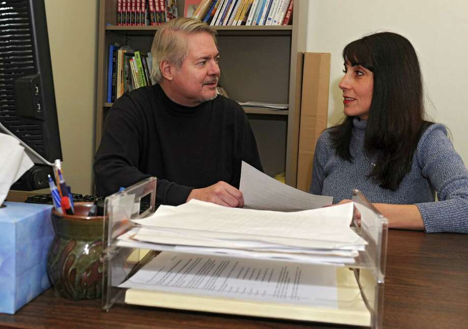 SUNY professor Dr. John Foldy and Bethany Gonyea, a biofeedback specialist, sit in Foldy's office at the University at Albany on Monday, Dec. 23, 2013 in Albany, N.Y. The duo are conducting a study to see if meditation reduces crime and creates more peace. (Lori Van Buren / Times Union) Photo: Lori Van Buren / 00025132A