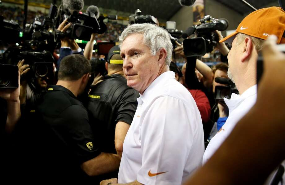 Oregon 30, Texas 7Record: 8-5Head coach Mack Brown of the Longhorns meets head coach Mark Helfrich of the Ducks. Photo: Ronald Martinez, Getty Images