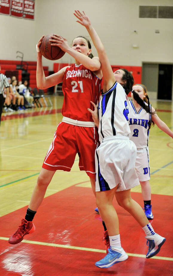 Greenwich's Abigail Wolf snares the rebound from Darien's Kaeleigh Morrill during the championship final of the 19th annual Tony LaVista Basketball Tournament at New Canaan High School in New Canaan, Conn., on Monday, Dec. 30, 2013. Greenwich won 66-36. Photo: Jason Rearick / Stamford Advocate