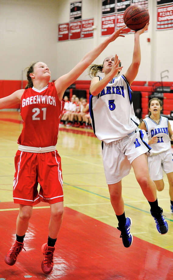 Darien's Emily Stein attempts to shoot over Greenwich's Abigail Wolf during the championship final of the 19th annual Tony LaVista Basketball Tournament at New Canaan High School in New Canaan, Conn., on Monday, Dec. 30, 2013. Greenwich won 66-36. Photo: Jason Rearick / Stamford Advocate