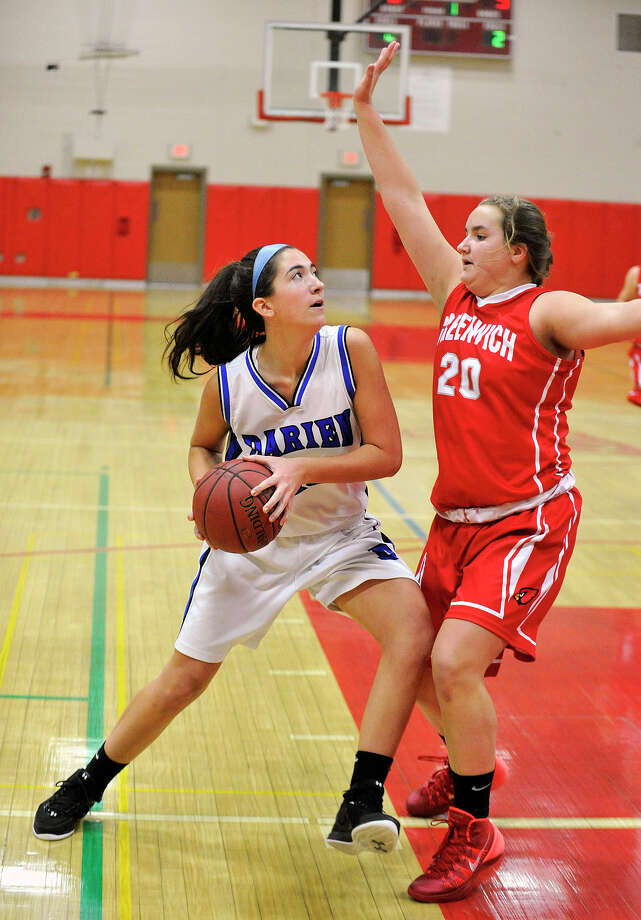 Darien's Julia Cornacchia is pressured by Greenwich's Emily Anderson during the championship final of the 19th annual Tony LaVista Basketball Tournament at New Canaan High School in New Canaan, Conn., on Monday, Dec. 30, 2013. Greenwich won 66-36. Photo: Jason Rearick / Stamford Advocate