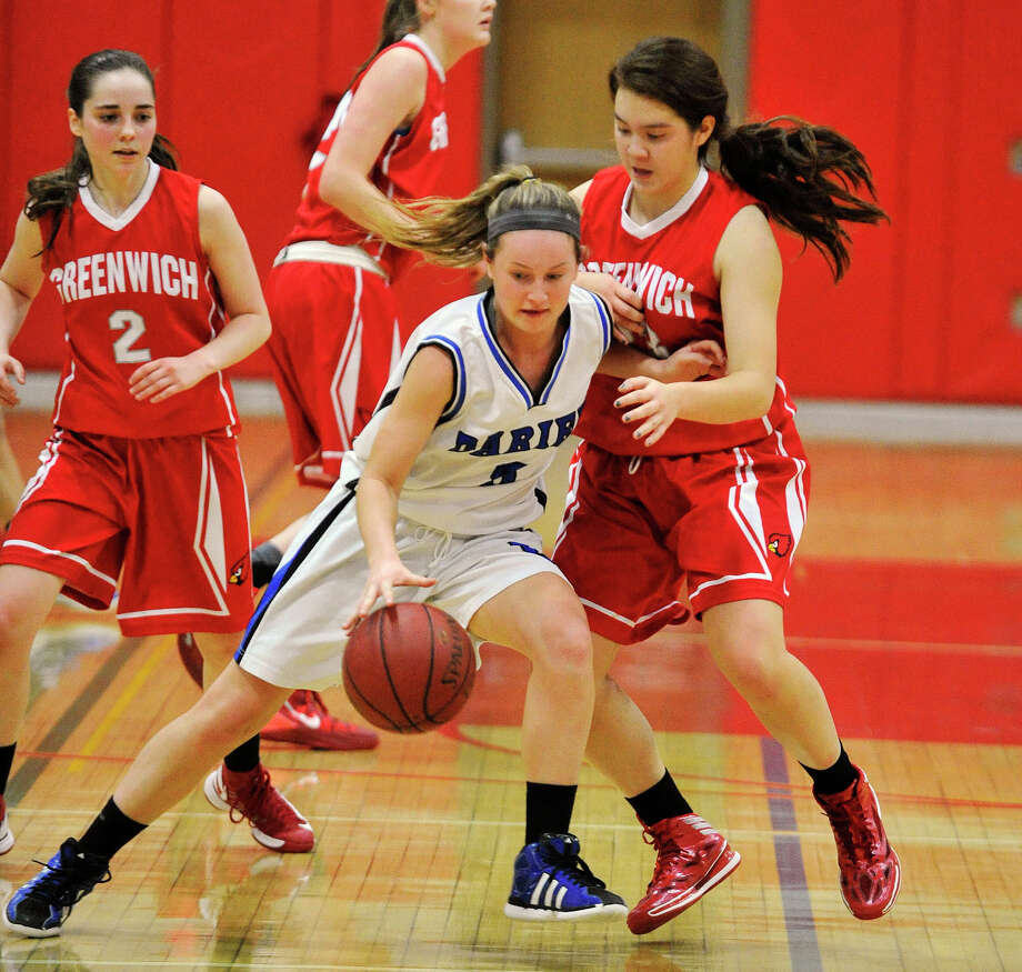 Darien's Emily Stein shields the ball from Greenwich's Jamie Kockenmeister during the championship final of the 19th annual Tony LaVista Basketball Tournament at New Canaan High School in New Canaan, Conn., on Monday, Dec. 30, 2013. Greenwich won 66-36. Photo: Jason Rearick / Stamford Advocate
