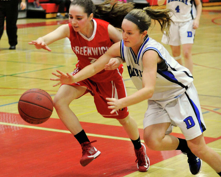Greenwich's Caroline Beneville and Darien's Emily Stein reach for the loose ball during the championship final of the 19th annual Tony LaVista Basketball Tournament at New Canaan High School in New Canaan, Conn., on Monday, Dec. 30, 2013. Greenwich won 66-36. Photo: Jason Rearick / Stamford Advocate