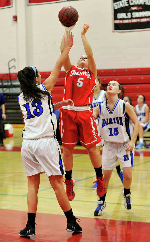 Greenwich's Rebecca DeCarlo shoots over Darien's Julia Cornacchia during the championship final of the 19th annual Tony LaVista Basketball Tournament at New Canaan High School in New Canaan, Conn., on Monday, Dec. 30, 2013. Greenwich won 66-36. Photo: Jason Rearick / Stamford Advocate