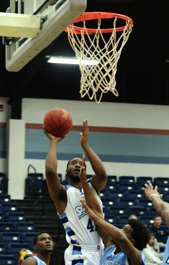 Port Arthur's Jamal Shabazz, No. 42, goes up for the basket against El Centro defenders during Monday night's game. Lamar State College-Port Arthur played against El Centro College during the Seahawks New Year's Classic in Port Arthur on Monday. Photo taken Monday, 12/30/13 Jake Daniels/@JakeD_in_SETX Photo: Jake Daniels / ©2013 The Beaumont Enterprise/Jake Daniels