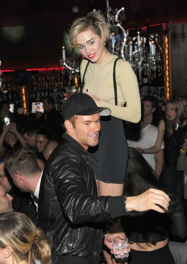 Kellan Lutz and Miley Cyrus attend Miley Cyrus' unveiling of Beacher's Madhouse Las Vegas at the MGM Grand Hotel & Casino on December 27, 2013 in Las Vegas, Nevada. Photo: Kevin Mazur, WireImage