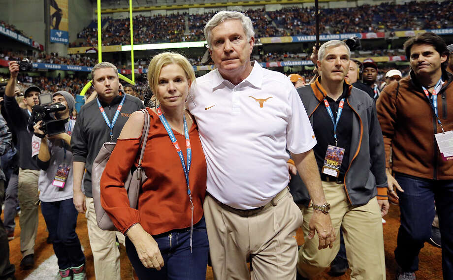 Texas Longhorns head coach Mack Brown and his wife Sally walk off the field after the Valero Alamo Bowl with the Oregon Ducks Monday Dec. 30, 2013 at the Alamodome. Oregon won 30-7. Photo: Edward A. Ornelas, San Antonio Express-News / © 2013 San Antonio Express-News