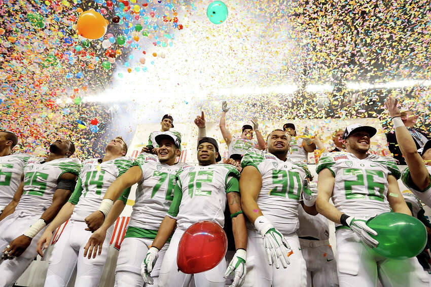 Members of the Oregon Ducks celebrate after the Valero Alamo Bowl with the Texas Longhorns Monday Dec. 30, 2013 at the Alamodome. Oregon won 30-7.