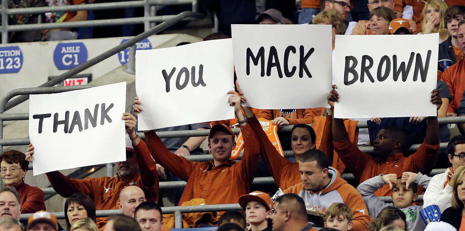 Texas Longhorns fans hold signs for Mack Brown during first half action of the Valero Alamo Bowl with the Oregon Ducks Monday Dec. 30, 2013 at the Alamodome. Photo: Edward A. Ornelas, San Antonio Express-News / © 2013 San Antonio Express-News