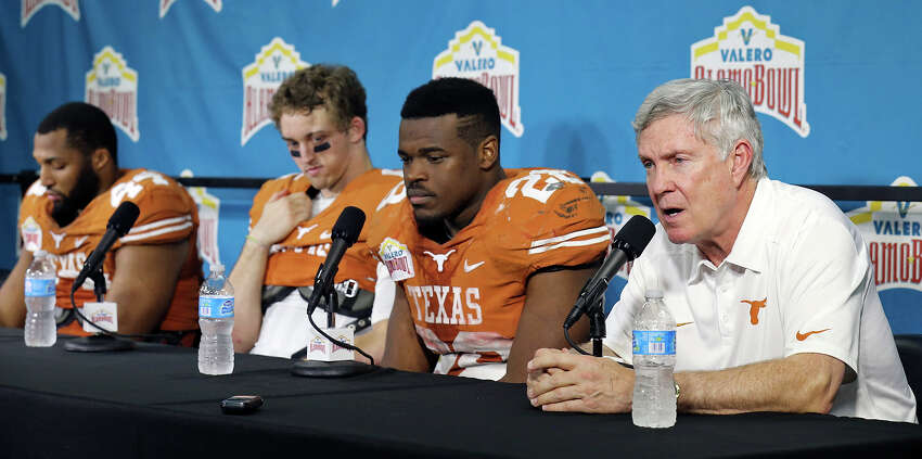 Texas Longhorns' Jackson Jeffcoat, (from left) Case McCoy, and Malcolm Brown listen to head coach Mack Brown speak during a press conference after the Valero Alamo Bowl with the Oregon Ducks Monday Dec. 30, 2013 at the Alamodome. Oregon won 30-7.