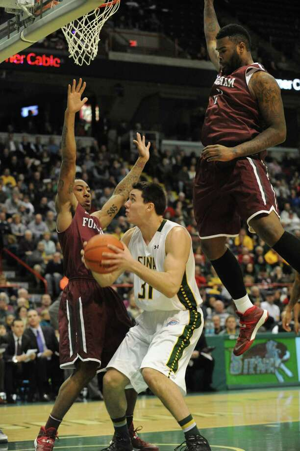 Siena's Brett Bisping is double guarded by Fordham's Mandell Thomas, left, and Tavion Leonard during a basketball game at the Times Union Center on Monday, Dec. 30, 2013 in Albany, N.Y. (Lori Van Buren / Times Union) Photo: Lori Van Buren / 00025111B