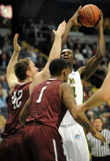 Siena's Imoh Silas goes up for a shot during a basketball game against Fordham at the Times Union Ce