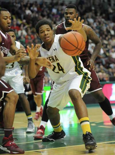 Siena's Lavon Long tries to grab a loose ball during a basketball game against Fordham at the Times