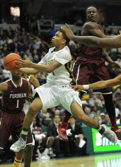 Siena's Marquis Wright goes up for a layup during a basketball game against Fordham at the Times Uni