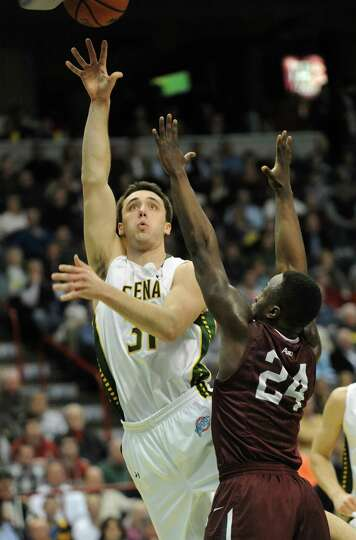 Siena's Brett Bisping goes up for a layp against Fordham's Bryan Smith during a basketball game at t