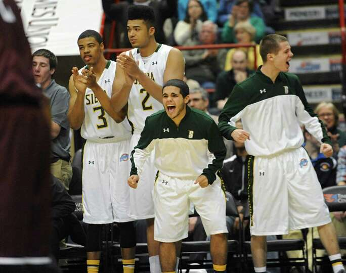The Siena bench stand up with excitement as their team takes the lead after being down during a bask