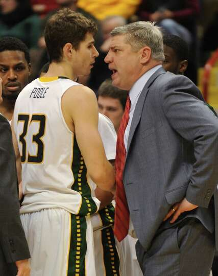 Siena's Rob Poole gets yelled at by head coach Jimmy Patsos during a basketball game against Fordham