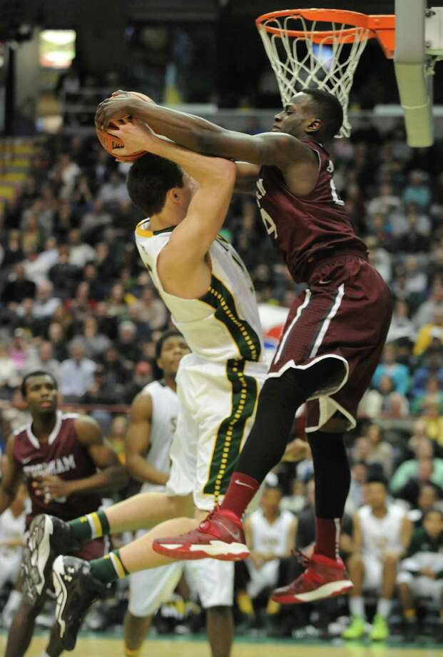Siena's Brett Bisping gets fouled by Fordham's Bryan Smith during a basketball game at the Times Union Center on Monday, Dec. 30, 2013 in Albany, N.Y. (Lori Van Buren / Times Union) Photo: Lori Van Buren / 00025111B
