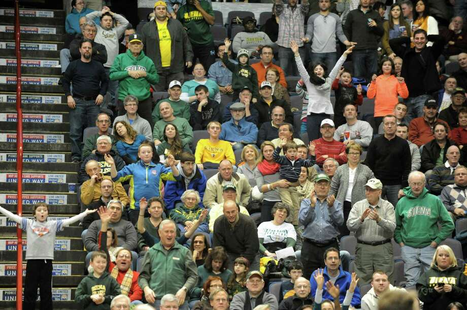 Siena fans have fun during a basketball game against Fordham at the Times Union Center on Monday, Dec. 30, 2013 in Albany, N.Y. (Lori Van Buren / Times Union) Photo: Lori Van Buren / 00025111B
