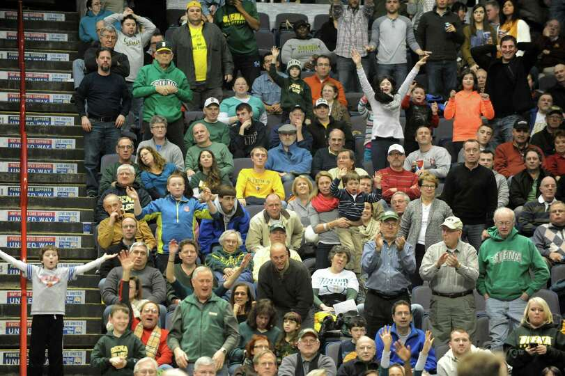 Siena fans have fun during a basketball game against Fordham at the Times Union Center on Monday, De