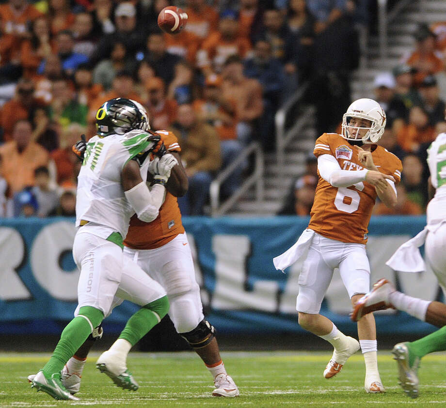 Texas quarterback Case McCoy passes against Oregon during first-half action of the Valero Alamo Bowl in the Alamodome on Monday, Dec. 30, 2013. Photo: Billy Calzada, San Antonio Express-News / San Antonio Express-News