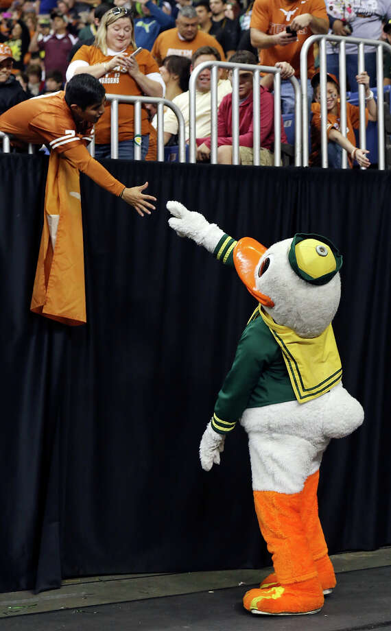 The Oregon Duck shakes hands with a Texas Longhorns fan before the Valero Alamo Bowl Monday Dec. 30, 2013 at the Alamodome. Photo: Edward A. Ornelas, San Antonio Express-News / © 2013 San Antonio Express-News