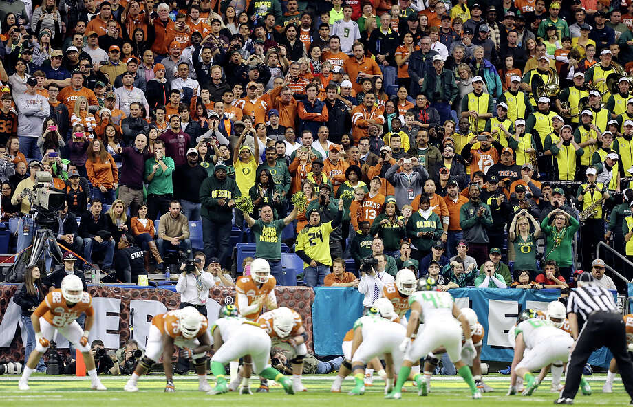 Football fans watch the Valero Alamo Bowl with the Texas Longhorns and Oregon Ducks Monday Dec. 30, 2013 at the Alamodome. Photo: Edward A. Ornelas, San Antonio Express-News / © 2013 San Antonio Express-News