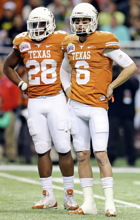 Texas Longhorns'  Malcolm Brown (left) and Texas Longhorns' Case McCoy wait for a play during first half action of the Valero Alamo Bowl with Oregon Ducks Monday Dec. 30, 2013 at the Alamodome. Photo: Edward A. Ornelas, San Antonio Express-News / © 2013 San Antonio Express-News