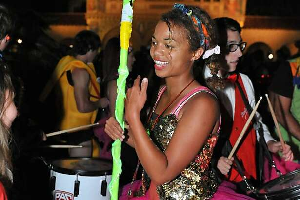 Annalise Lockhart, the Leland Stanford Junior University Marching Band drum major, leads the Band at Full Moon on the Quad, a yearly campus tradition, at Stanford University, on October 22, 2013.