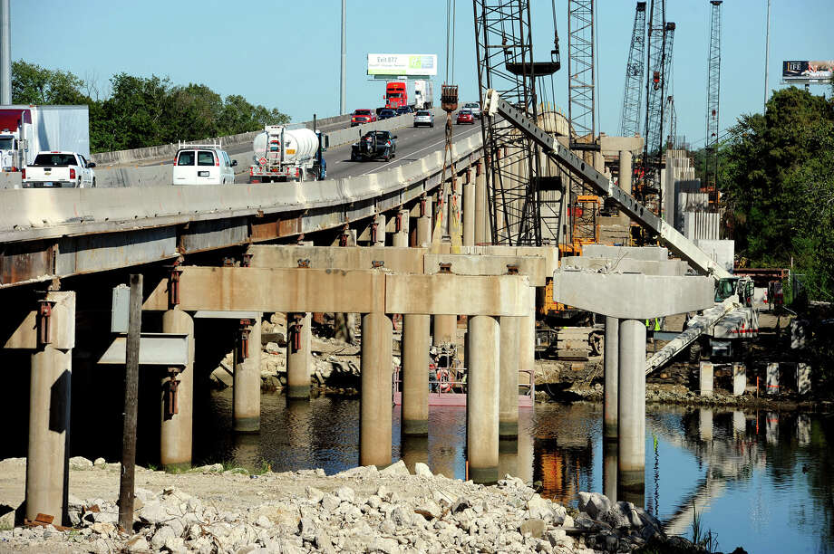 Very few sections still remain from the east bound lanes of the Purple Heart Bridge. Workers say the section will be completely removed and construction on the new lanes will push forward in late November. Some of the concrete columns are already in place to support the new lanes.  Photo taken Monday, October 07, 2013 Guiseppe Barranco/The Enterprise Photo: Guiseppe Barranco, Photo Editor