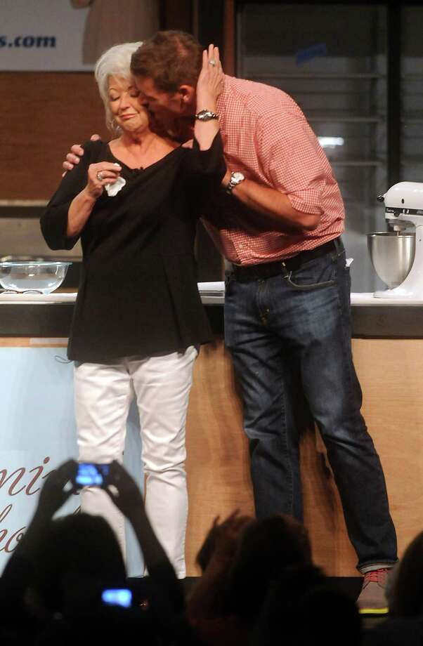 Chef Paula Deen is consoled by son Jamie after taking the stage at the Metropolitan Cooking Show in Houston, three months after admitting to using a racial slur.  • Houston greets the chef with cheers Photo: Dave Rossman, Freelance / © 2013 Dave Rossman