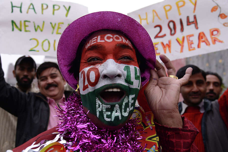 An Indian reveler poses on New Year's Eve in Amritsar on December 31, 2013. Indians are preparing to welcome 2014, in contrast to last year which saw the country cancel most of its official New Year's celebrations after the fatal gang rape of a student on a New Delhi bus on December 16, which sparked protests and a year of introspection about women's rights. Photo: NARINDER NANU, AFP/Getty Images / 2013 AFP