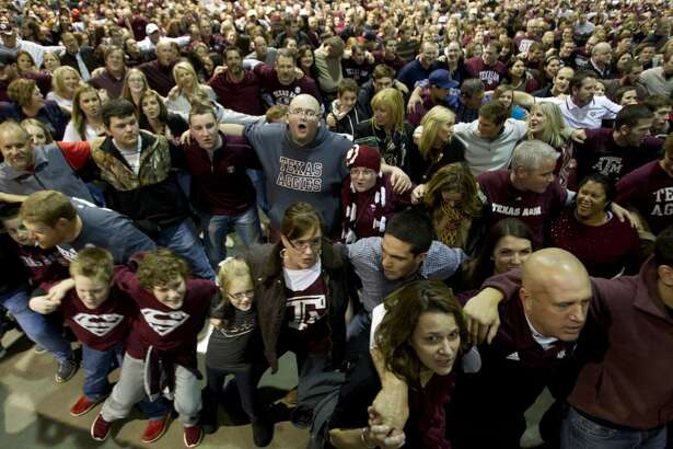 A&M fans cheer during Midnight Yell practice at the Georgia World Congress Center.