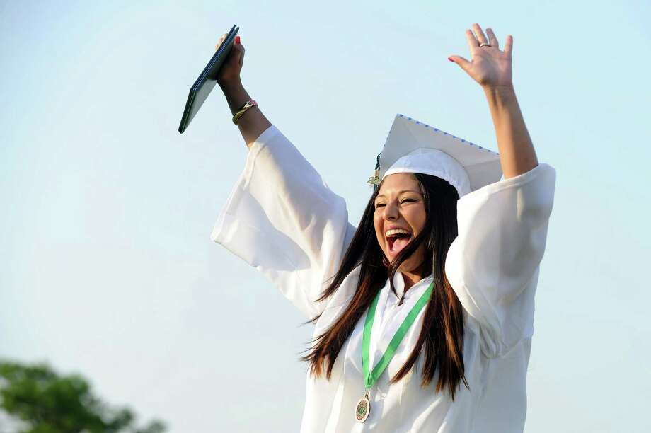 Jessica Jaramillo celebrates after getting her diploma during Friday's commencement ceremony at Norwalk High School on June 21, 2013. Photo: Lindsay Perry / Stamford Advocate