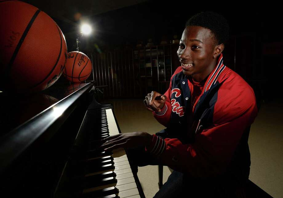 As talented on the court as he is the keys, West Orange-Stark's point guard Laquarius Paige has been scouted by  Harvard and Rice. Laquarius says he does not read music, but can play the piano, guitar and other instruments by ear.  Photo taken Wednesday, October 16, 2013 Guiseppe Barranco/The Enterprise Photo: Guiseppe Barranco, Photo Editor
