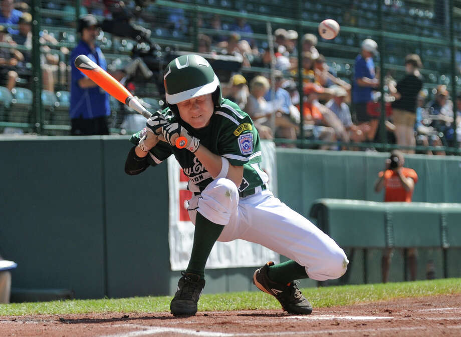 Westport's Drew Rogers ducks a pitch, during Little League World Series action against Mexico in Williamsport, Pa. on Sunday August 25, 2013. Mexico beat Westport 15-14. Photo: Christian Abraham / Connecticut Post contributed
