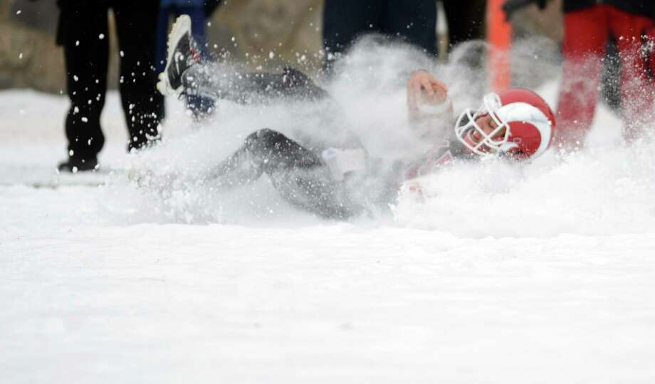 New Canaan's Nick Cascione showed his all-state caliber skills on a bitter cold and snowy day at Stamford's Boyle Stadium against Darien in the Class L championship game. Photo: Autumn Driscoll / Connecticut Post