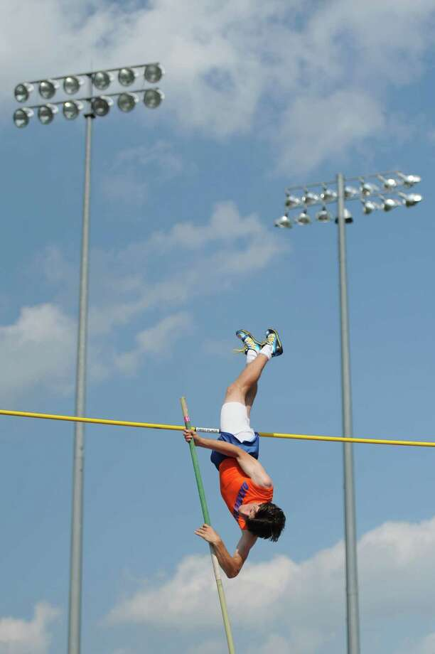 Danbury's Leland Roberts competes in the boys pole vault at the FCIAC Track and Field Championships at Danbury High School in Danbury, Conn. on Tuesday, May 21, 2013.  Roberts set a school record, clearing a height of 14-06.00, and finished second overall in the event. Photo: Tyler Sizemore / The News-Times