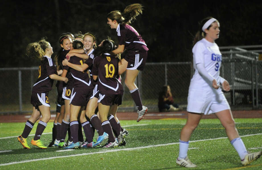 St. Joseph players celebrate Jenna Bike's second half goal that gave the Cadets a 1-0 lead on their way to a 2-0 victory over Glastonbury in the State Class LL girls soccer semifinals at West Haven High School on Monday, November 11, 2013. Photo: Brian A. Pounds / Connecticut Post