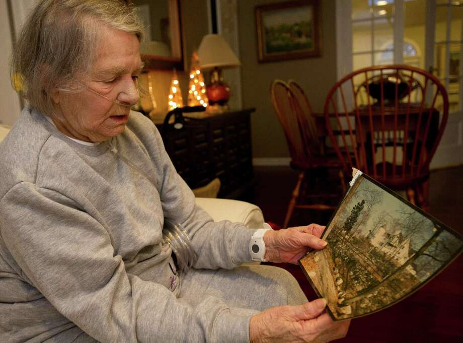 Isabel Apicella talks about her family's history in Stamford as she holds an old photo of Brookwoods, the family estate, at her daughter's home on Thursday, December 26, 2013. Photo: Lindsay Perry / Stamford Advocate