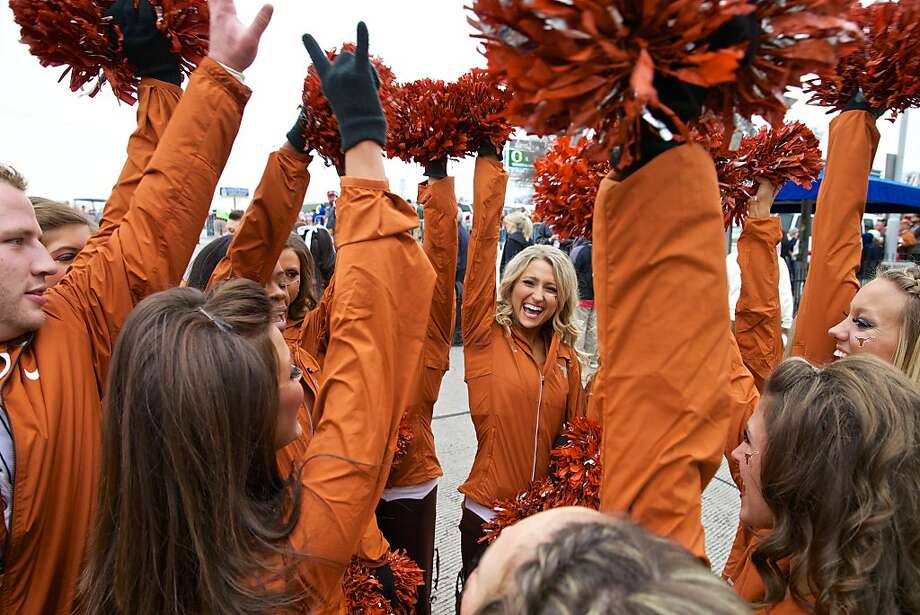 The Texas Longhorns cheerleaders do the perfect cheer before the team enters the stadium for the Valero Alamo Bowl in San Antonio, Texas, at the Alamodome, Mon, Dec 30, 2013.  Photo: Thomas Boyd, Associated Press