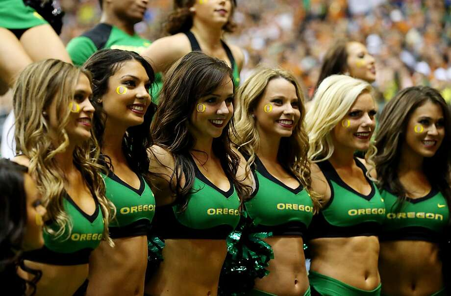 Oregon Ducks cheerleaders perform during the Valero Alamo Bowl against the Texas Longhorns at the Alamodome on December 30, 2013 in San Antonio, Texas.  Photo: Ronald Martinez, Getty Images