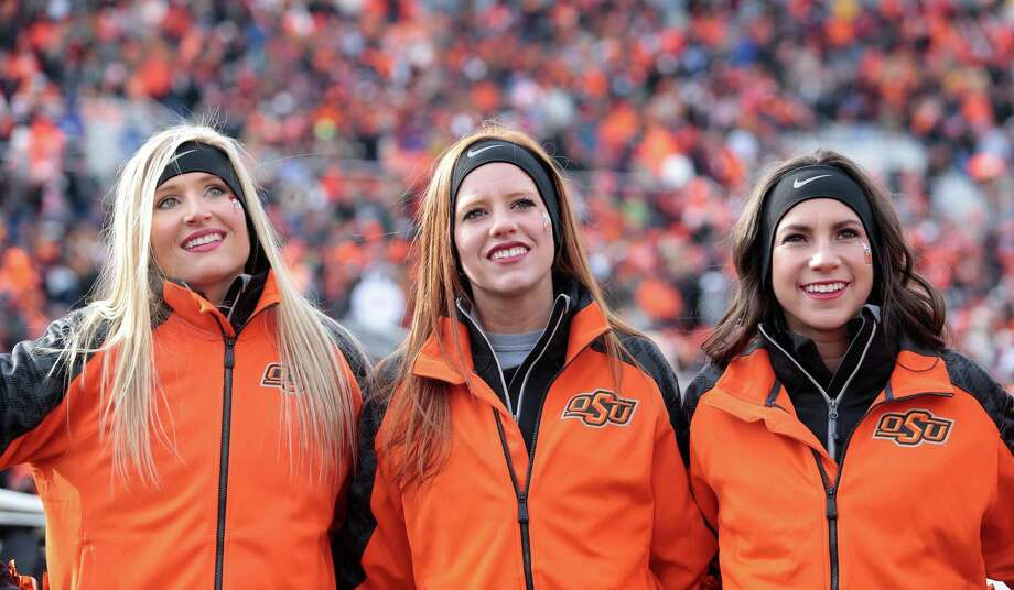 Oklahoma State Cowboys' cheerleaders sing the school song before the game. Photo: Brett Deering, Katie Dowd / 2013 Getty Images