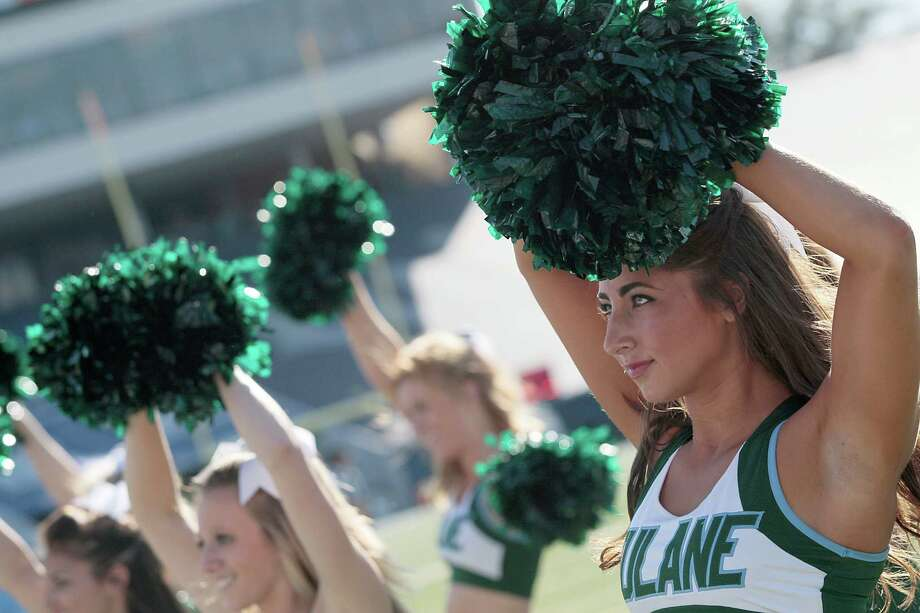 Tulane Green Wave cheerleaders cheer against the Rice Owls on November 30, 2013 at Rice Stadium in Houston, Texas. Photo: Thomas B. Shea, Katie Dowd / 2013 Thomas B. Shea