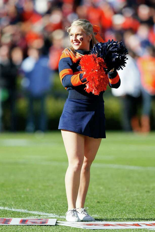 An Auburn Tigers cheerleader performs during their game against the Alabama Crimson Tide at Jordan-Hare Stadium on November 30, 2013 in Auburn, Alabama. Photo: Kevin C. Cox, Katie Dowd / 2013 Getty Images
